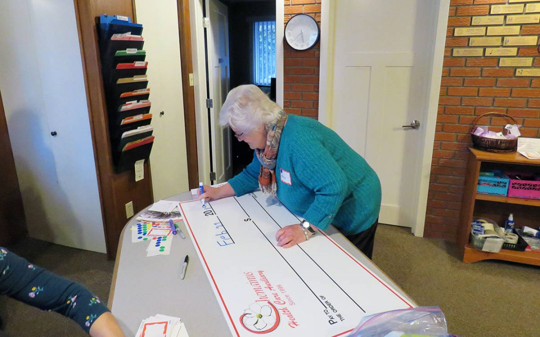 Chemainus Health Care Auxiliary present cheque for $50,000